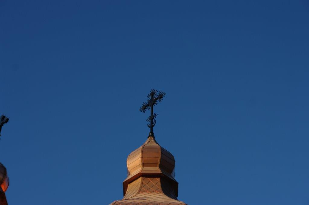 copper church tower with cross