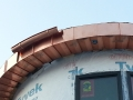 round copper gutter installed on round roof