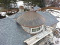 copper roof with copper turret with round copper gutter