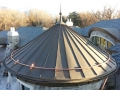 Radius standing seam snow guard