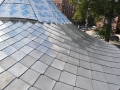 close up of terne stainless shingles custom made for a witch hat turret