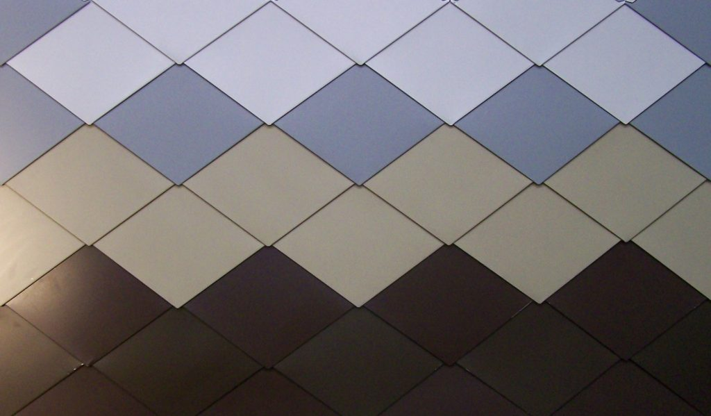 Interlocking Metal Shingles For Roofing And Wall Cladding
