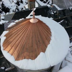 copper turret with snow