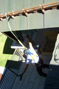 hanging from safety harness from copper snow guards