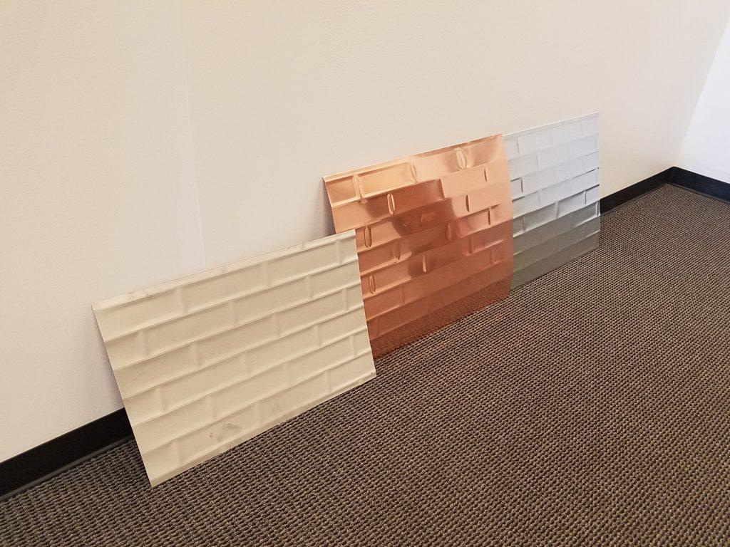 Embossed Metal Panels In A Subway Tile Motif For